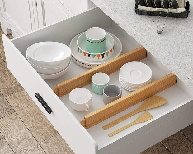 photo showing to bamboo drawer organizers in a small drawer