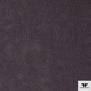 Lilac colored novelty wool fabric from Italy