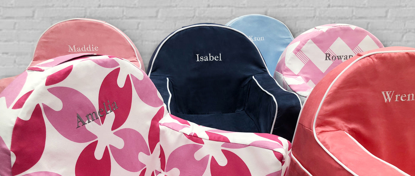 Little Reader Toddler Chairs - Comfy foam, supple fabric, arm rests and book pocket create the perfect seat for toddlers.