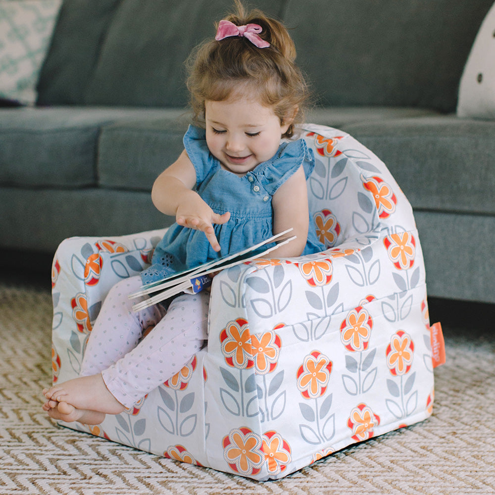 Little Reader Toddler Chair - Comfy foam, supple fabric, arm rests and book pockets plus a wide contoured seat and ergonomic arms for maximum comfort.