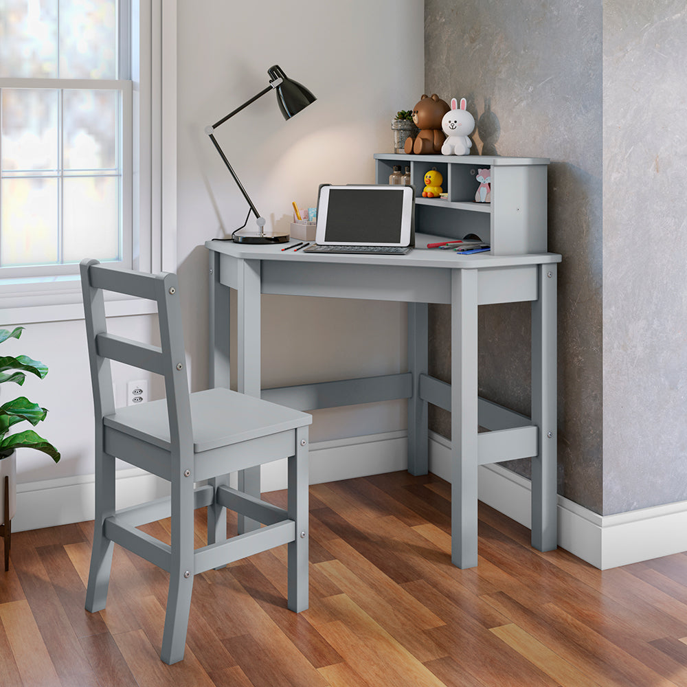 P'kolino Kids Corner Desk and Chair in Grey. This sturdy desks tucks nicely into any corner and comes with a reversible hutch can be placed on either side of the desk. Three cute cubbies provide extra storage space and can hold crayons and art supplies.