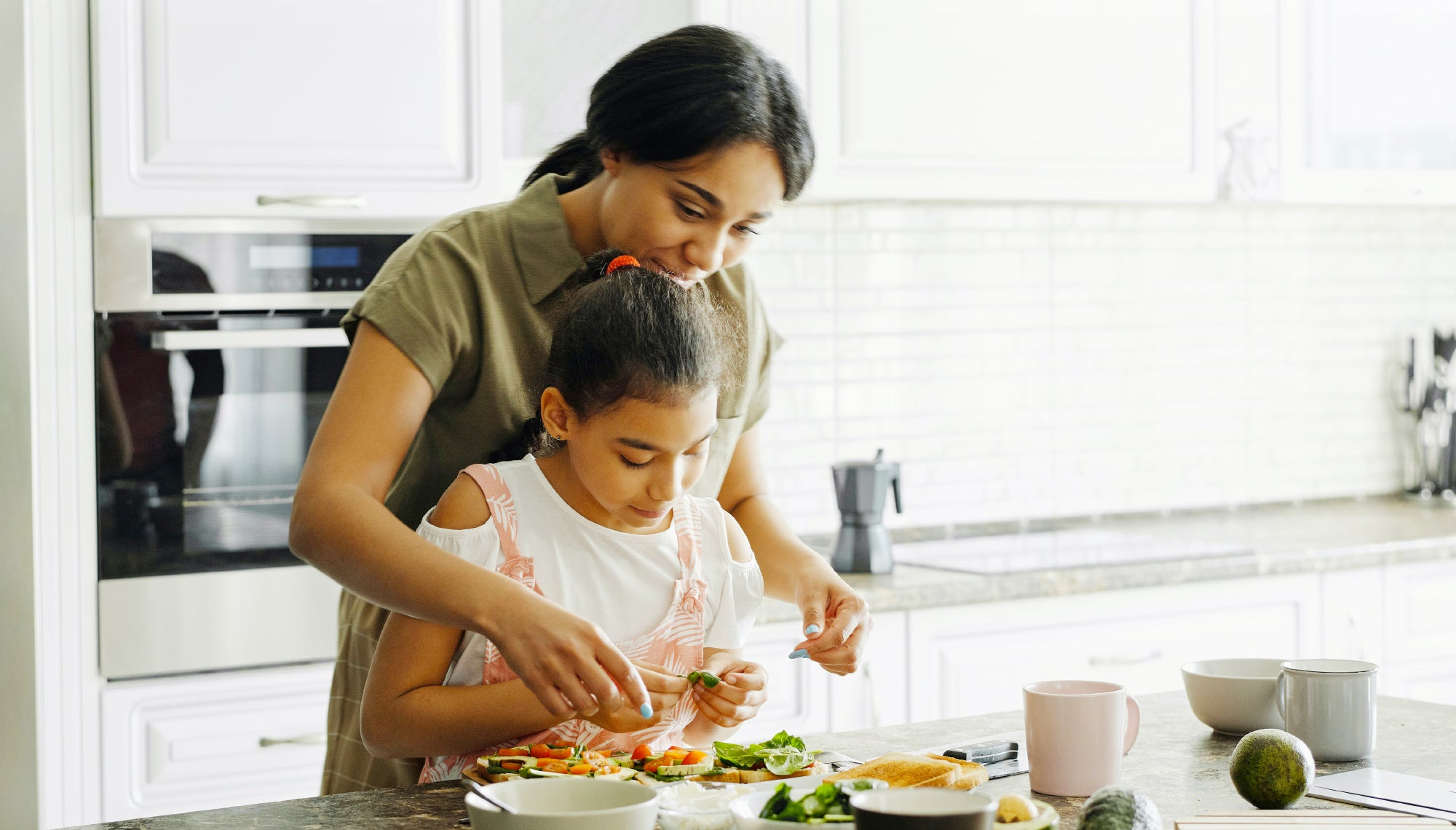 Mom and child making lunch