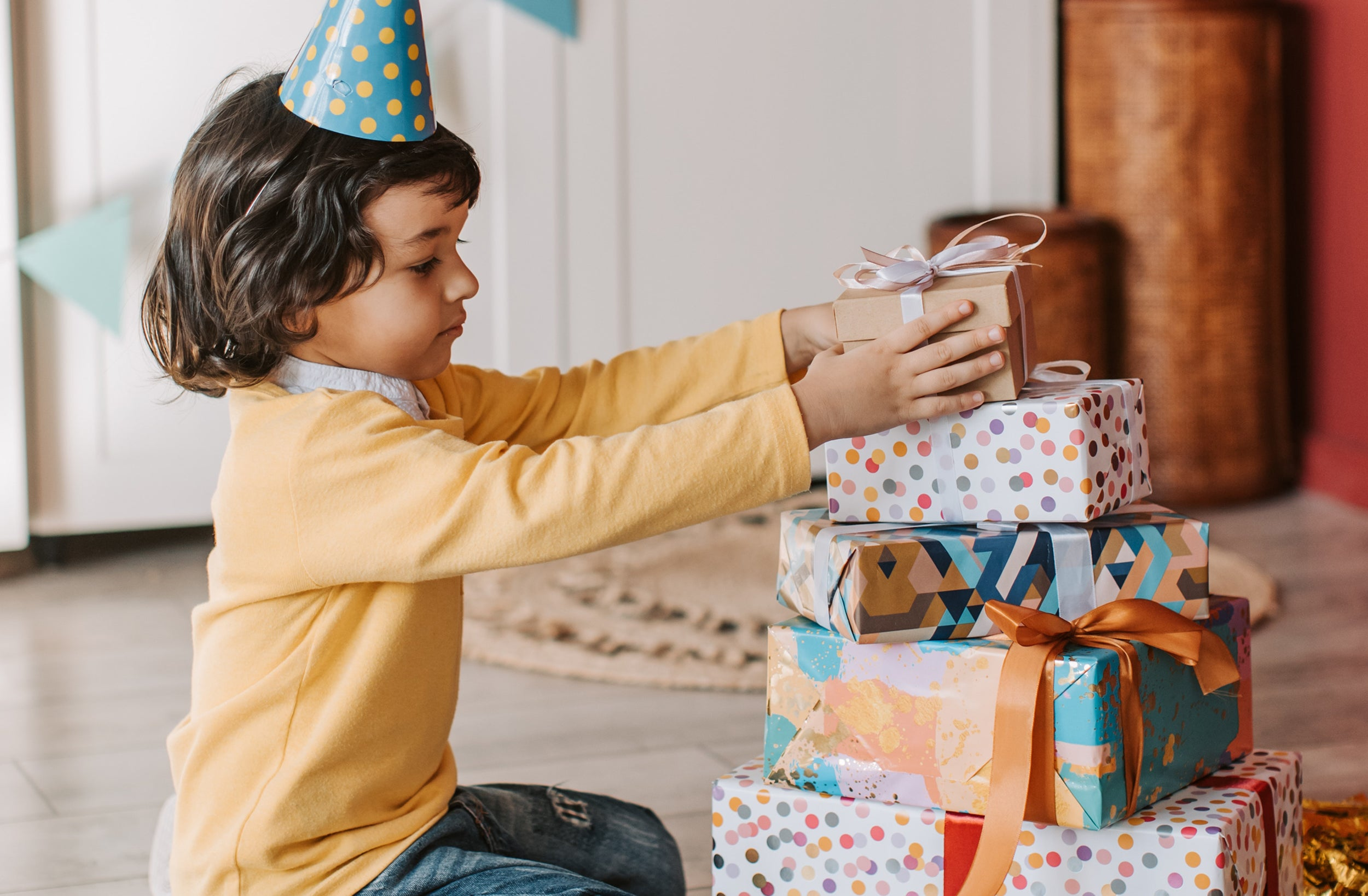 Boy with pile of presents