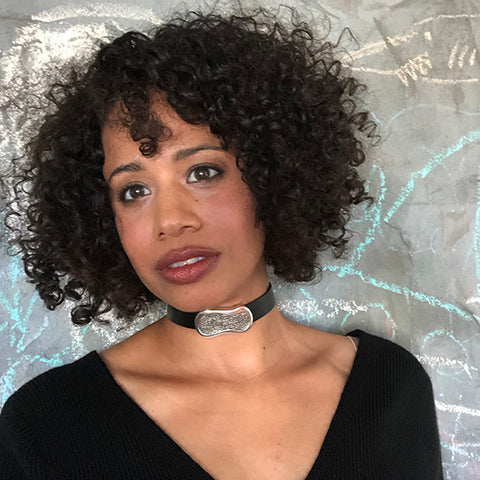curly hair girl wearing C.W. James leather choker