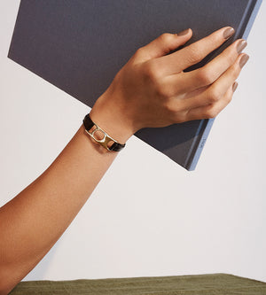 C.W. James jewellery Viola bracelet on model with book