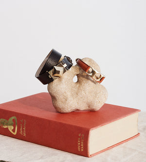 brass and leather double wrap bracelet still life with book