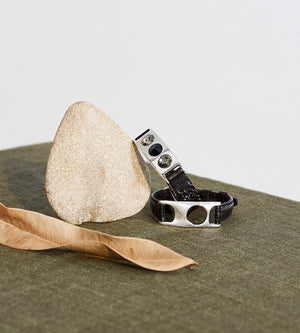 still life photo leather and silver bracelets