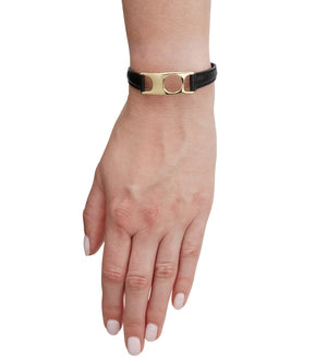 C.W. James jewellery Viola bracelet black leather and brass on model