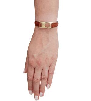 C.W. James jewelry Viola bracelet brown leather and brass on hand