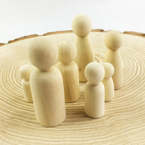 Family of Unpainted  Wooden Peg Dolls ( set of 7)