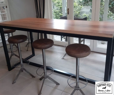 Bespoke/custom made 40mm solid Oak and tubular metal bar table and barstools, made by vintage-etc in cape town and Johannesburg. We make custom made & bespoke tables, benches, free-standing kitchen islands, desks, media units & wardrobes in our Cape Town & Johannesburg workshops - using Oak, Oregon, Ash, Beech, Birch Ply & Meranti. We also sell imported furniture, provide design consulting services & make soft furnishing e.g. sofas & upholstered chairs in linen, velvet & stain resistant fabric