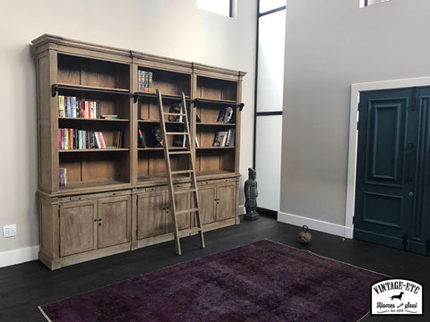 Library Unit with a purple over dyed Persian Rug