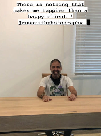 Happy client receiving his Bespoke natural Grade A solid Oak and matte black tubular metal sleek desk, installed for well-known Cape Town photographer, custom made by vintage-etc. A functional sleek design with hidden cable holes for extra wires. We make custom made & bespoke tables, benches, free standing kitchen islands, desks, media units & wardrobes in our Cape Town & Johannesburg workshops – using Oak, Oregon, Ash, Beech, Birch Ply & Meranti. We also sell imported furniture, provide design consulting services & make soft furnishings e.g. sofas & upholstered chairs in linen, velvet & stain resistant fabric.
