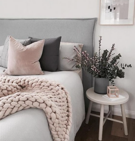 grey blush copper trend in bedroom with chunky knit blankets