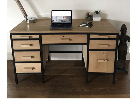 The desk was custom made from Solid Grade A Oak and matte black tubular metal.