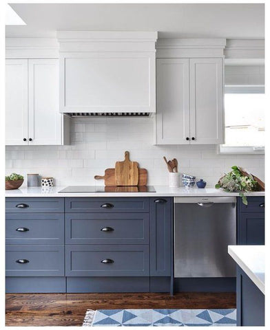 blue and white two-toned cabinets with wooden flooring, a rug and white walls in kitchen.  Interior Design blog about how Europe does accent colours through two-toned cabinetry, accent ceiling and deep, dark doorways, skirting and architraves. Get the look with Vintage-etc. We make custom made & bespoke tables, benches, free-standing kitchen islands, desks, media units & wardrobes in our Cape Town & Johannesburg workshops - using Oak, Oregon, Ash, Beech, Birch Ply & Meranti. We also sell imported furniture, provide design consulting services & make soft furnishing e.g. sofas & upholstered chairs in linen, velvet & stain resistant fabric