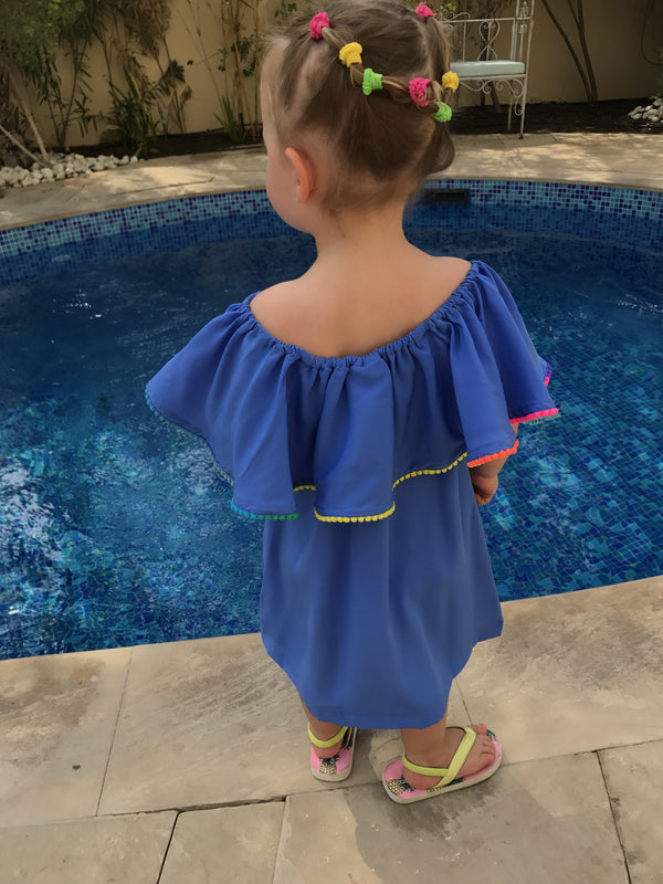 The Little Ruffle Dress - Cornflower Blue with mini pom-poms