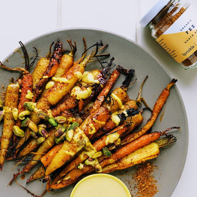 Sticky sweet roasted carrots with turmeric tahini dressing & pistachios