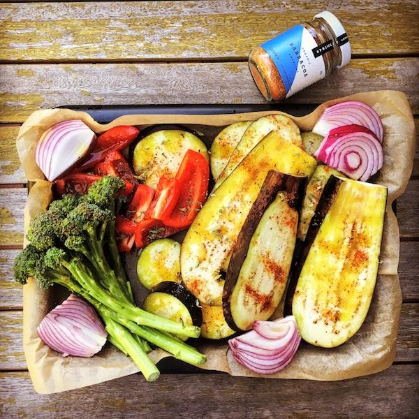 Dish of roasted vegetables seasoned with Barbacoa spice blend on wooden table