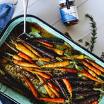 Roast vegetables in white baking dish seasoned with Black Smoke spice blend