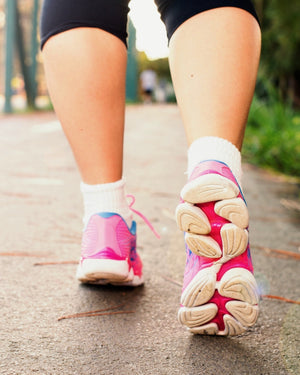 Close-up of woman's legs, walking in trainers - keep those resolutions going!