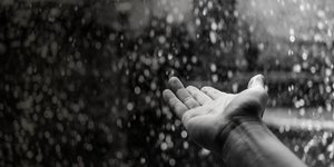 Outstretched hand in the rain - touch a life and touch the future