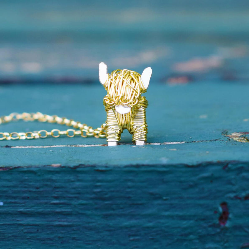gold highland cow necklace, gold highland cow jewellery. gold cow