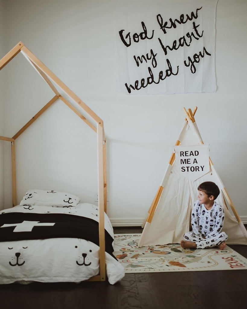 Cozy kid space with house shaped bed frame
