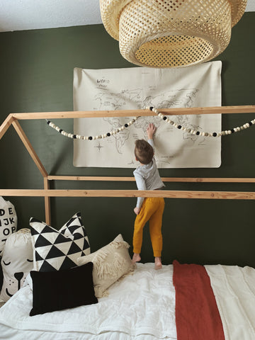 Kids bedroom with green accent wall