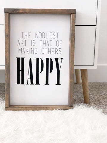 Wood Framed Sign- The Noblest Art is That of Making Others Happy