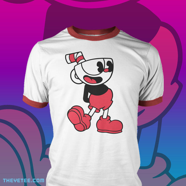 Red and white ringer style tee. Collar and sleeve seams are red. Centered is Cuphead posing with his arms behind his back and smiling.  - Steamboat Cuphead