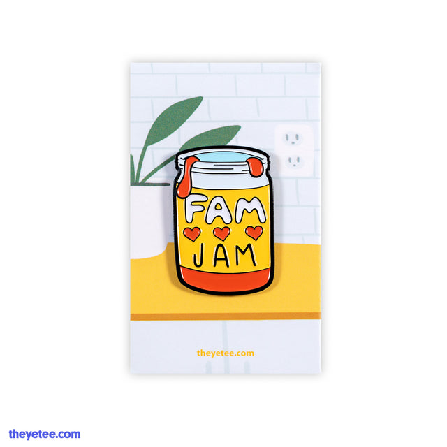 "A 1.25"" tall pin of an open jar filled with red jam. On the jar's label are the words FAM JAM separated by three hearts.  - Fam Jam"