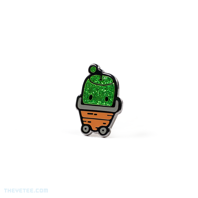 Hard enamel pin of a green sparkly Junimo- a forest spirit in Stardew Valley riding in a garden cart - Forest Spirit Pin