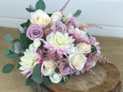 Bridal Bouquet done by gig Morris florist in Belmar, New Jersey at Crystal Point in Pt. Pleasant, NJ with dahlias, roses in a pink, blush and cream color palette