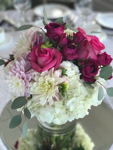 Floral Centerpieces done by gig Morris florist, nj at crystal point in pt. pleasant, nj with hydrangea, roses, spray roses, and dahlias in pinks and creams