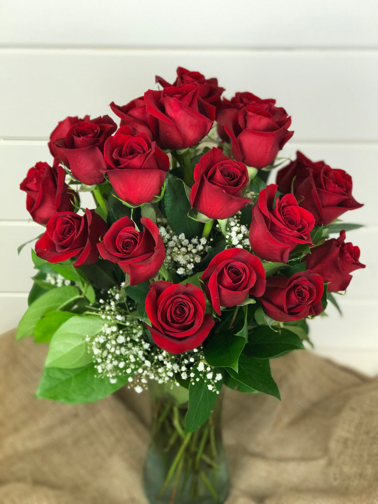Roses in a vase from a local flower shop in Belmar, New Jersey Gig Morris Florist