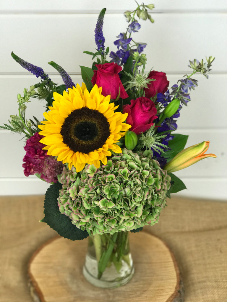 A wildflower collection for the fall of sunflowers, antique hydrangea, roses, Larkspur and other fall favorites of custom florals