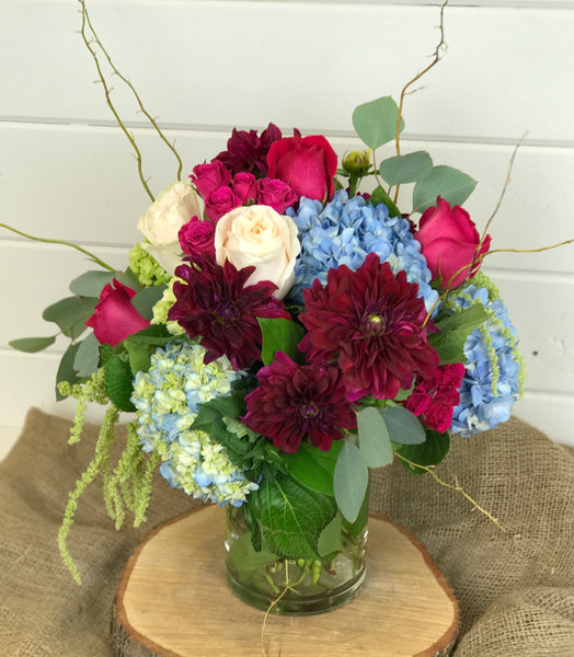 fall collection of dahlias, roses, hydrangea, birch branches, amaranthus, eucalyptus in Burgundy, blue and white