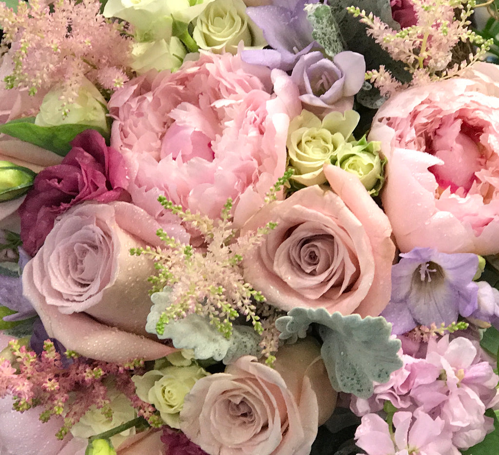 girly, feminine colors including pink, blush, lavender, purple, white and cream flowers