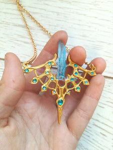 gold necklace with blue encrusted jewels