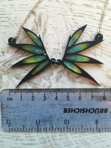 necklace of fairy wings and ruler showing 8cm in size