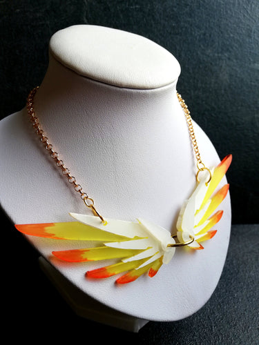mercy wings necklace on white display