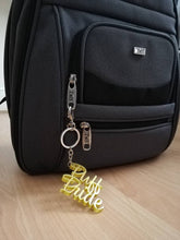 hufflepuff pride keychain in bag