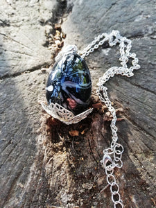 Black dragon egg pendant with metal filigree detailing - Geek And Artsy