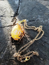 Gold Dragon egg pendant with metal filigree detailing - Geek And Artsy