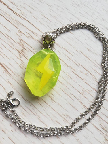 Pokemon thunder stone necklace - Geek And Artsy