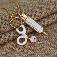 Gold Tone and White Stethoscope Syringe Necklace