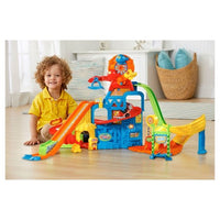 55/5000 VTech® Go! Ir! Rodas Inteligentes Race & Play Adventure Park