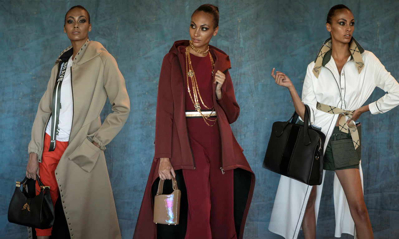 Women wearing designer clothing & luxury jewelry, holding handbags & designer totes