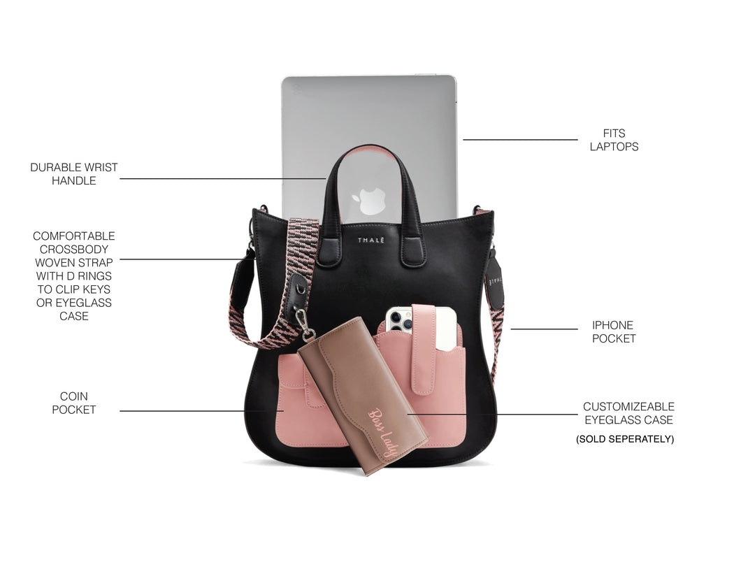 Luxury tote bag carrying laptop and phone